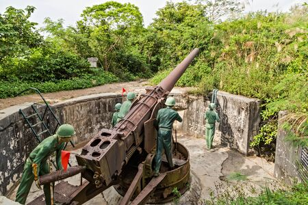 Cat Ba Island, Lan Ha Bay, Vietnam - November 30, 2014: Soldier on the battlefield artillery cannon gun. Canon Fort has the underground tunnel system linked together by stone trenches Editorial