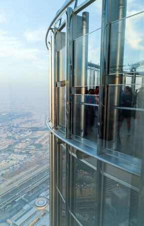 DUBAI, UAE - JANUARY 23, 2016: Burj Khalifa 124th Floor Observation Deck. Tower Burj Khalifa View from Top. Dubai building architecture, UAE Standard-Bild - 129426246