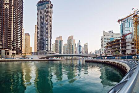 DUBAI, UAE - January 25, 2016: Dubai skyscrapers, hotels near The Walk at JBR on Dubai Marina World Tallest Tower travel and tourism Dubai, United Arab Emirates