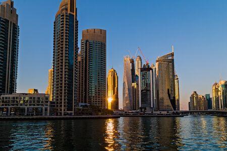 DUBAI, UAE - January 24, 2016: Buildings of Dubai Marina bay view skyscrapers, modern cityscape, downtown with blue sky, city at Middle East, Dubai, United Arab Emirate. 新聞圖片