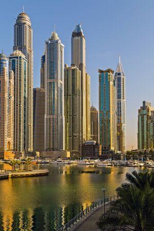 DUBAI, UAE - January 24, 2016: Dubai skyline towers Skyscrapers architecture of a big city. Persian Gulf shoreline Dubai, United Arab Emirates. 新聞圖片