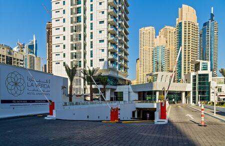 DUBAI, UAE - January 24, 2016: Underground Garage Parking famous Dubai Marina skyline towers Skyscrapers architecture of a big city. Persian Gulf shoreline Dubai, United Arab Emirates.