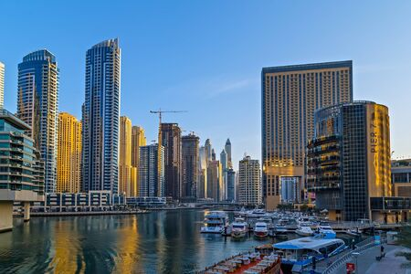 DUBAI, UAE - January 25, 2016: Dubai skyscrapers hotels near The Walk at JBR, Modern buildings on Dubai Marina World Tallest Tower travel and tourism Dubai, United Arab Emirates 新聞圖片