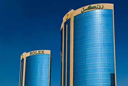 DUBAI, UAE - January 23, 2016: Dubai Twin Towers or Rolex Towers are located in eastern Dubai, United Arab Emirates, in Deira, DUBAI CREEK, DUBAI UAE Editorial