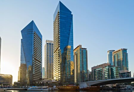DUBAI, UAE - January 25, 2016: Modern buildings on Dubai Marina World Tallest Tower travel and tourism Dubai, United Arab Emirates