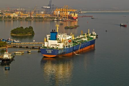 Halong City, Quang Ninh Province, Vietnam - November 28, 2014: Halong Pier From Cai Lan International Ship Ports. Oil ship tanker park to port for transfer crude oil to oil refinery.