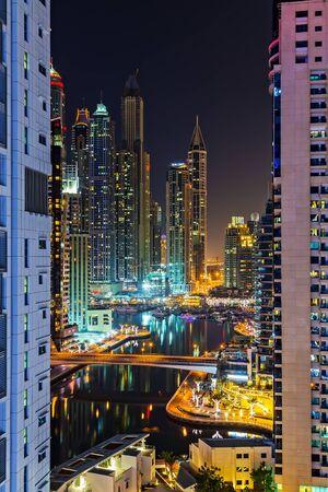 Dubai, UAE - January 24, 2016: Dubai Marina aerial panoramic view cityscape by night, illuminated skyscrapers and the persian gulf.