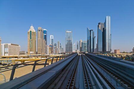 DUBAI, UAE - January 24, 2016: The construction cost of the Dubai Metro, View of Dubai with subway and skyscrapers