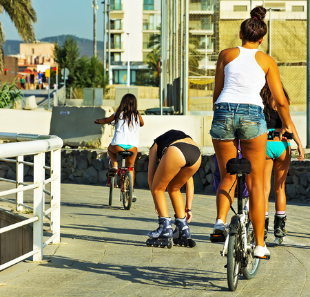 outdoor workouts girl training roller skating, cycling, woman denim shorts active losing weight. Healthy Sports concept.
