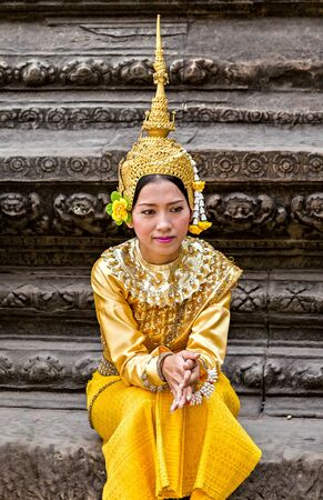 SIEM REAP, CAMBODIA - March 01, 2015: Traditional Cambodian Apsara dressed professional dancers, temples of Angkor Wat is a popular tourist attraction.