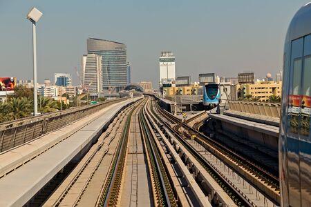 DUBAI, UAE - January 24, 2016: Dubai Metro Network line on the urban Frame building architecture UAE, subway monorail train automated. Station construction automated urban metro subway systems.