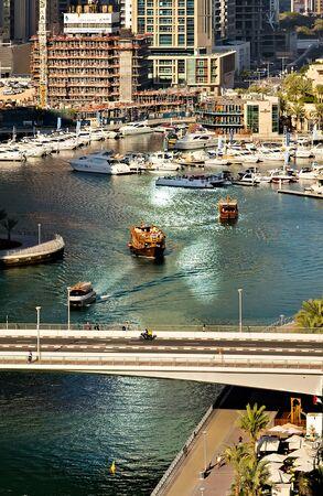 DUBAI, UAE - JANUARY 24, 2016: Dubai Marina Canal, yacht trip Dubai speedboat tour cruises