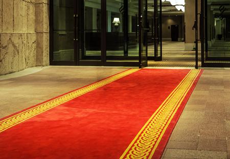 Red rolling carpet five star hotel entrance door