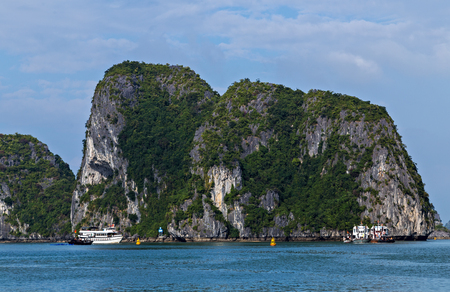 Halong bay islands sea landscape natural background. Rock islands in South China Sea, Vietnam. Tourist attraction of Halong bay islands, spectacular limestone karsts, grottos natural cave formations.