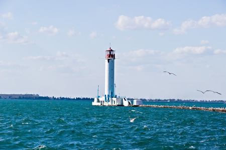 Lighthouse navigational by the sea. Harbor Odessa lighthouse Vorontsov, Ukraine.