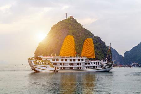 Discover Halong Bay Top Destinations Vietnam. Cruse liner golden Sails liner ship wooden junk sailing rock islands the emerald waters of Ha Long Bay.