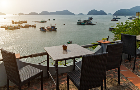 Restaurant sea terrace panoramic view seascape. interior terrace summer cafe. terrace by the seaside. Coast of Cat Ba Island is one of the only populated islands in Ha Long Bay. Ha Long Bay Cruises.