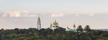 Krestovozdvizhensky Monastery landscape, Poltava panoramic city view Cross Exaltation Womens Monastery. Bell tower easter church cupolas. Travel in Poltava land. Stok Fotoğraf