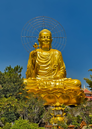 Golden Buddha Meditating sitting lotus in buddhist temple. Buddhist holiday - Happy Bodhi day achieved enlightenment. Stock Photo