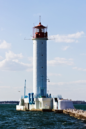 Red lighthouse building. Harbor Odessa lighthouse Vorontsov, Ukraine. Imagens
