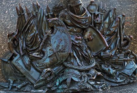 Monument of Glory fragment military bas-relief war soldier battle warrior bronze background. Poltava. Ukraine.