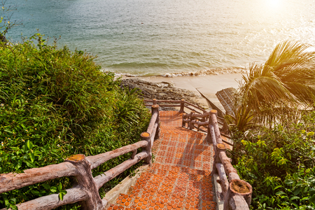 Cat ba down the famous steps of the stair in rocky island city beautiful beach and tropical sea Cat co, Vietnam