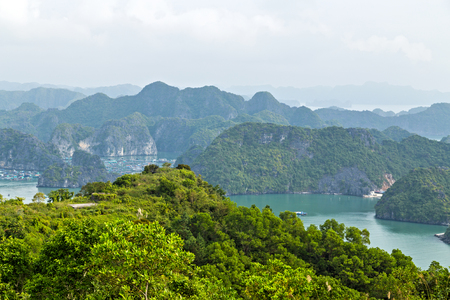 Halong bay islands mountains formations in South China Sea, Vietnam. Tourist attraction of Halong bay islands, spectacular limestone karsts, grottos natural cave formations.