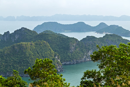 Halong bay from Cat Ba Island islands mountains in South China Sea, Vietnam. Tourist attraction of Halong bay islands, spectacular limestone karsts, grottos natural cave formations.