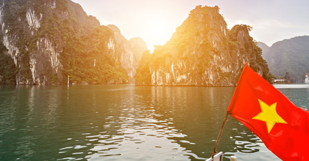 Vietnam Flag limestone rocks at Ha Long Bay. Halong Bay Tour Cruise Discover Rocky islands spectacular limestone, northern Vietnam