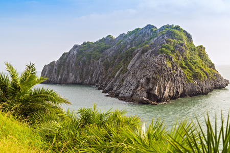 Cat ba rocky island scenery of the coast in the tropical sea Cat co, crystal clear blue water and a sunny summer blue sky at the horizon. Vietnam