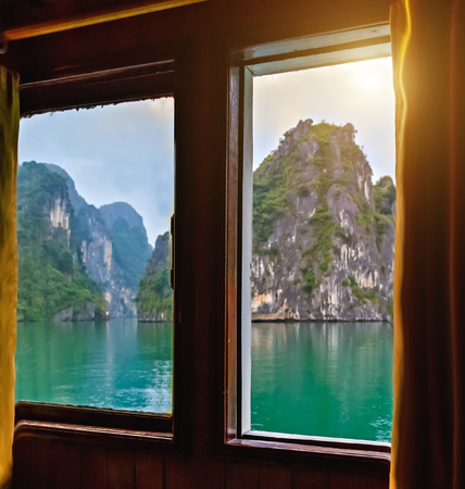 stateroom with fixed window, Halong Bay Top Destinations Vietnam. Cruise wooden junk sailing rocky islands the emerald waters of Ha Long Bay.