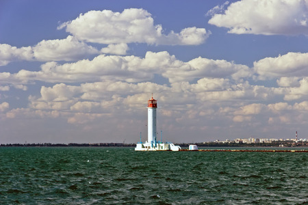 Harbor Odessa lighthouse Vorontsov. lighthouse sea landscape with blue sky, Ukraine.