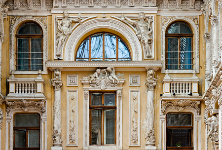 Shopping mall OdessaPassage. Exterior facade window of the Passage building are decorated by numerous sculptures. Close up Marble body naked woman old stone statue detail white marble sculpture. Editöryel
