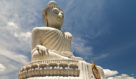 Big white Buddha statue Meditating in buddhist temple. Buddhist holiday - Happy Bodhi day achieved enlightenment. Stock Photo