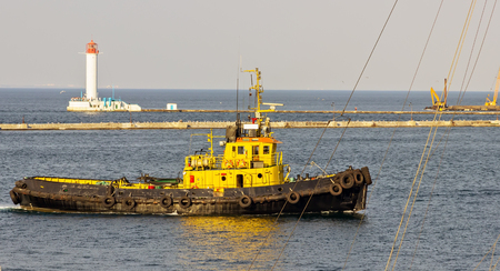Pilot boat cruise liner ship harbor lighthouse in the Black Sea port of Odessa, Ukraine