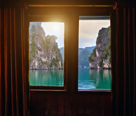 Oceanview Stateroom with Window Halong Bay Top Destinations Vietnam. Cruise wooden junk sailing rocky islands the emerald waters of Ha Long Bay.