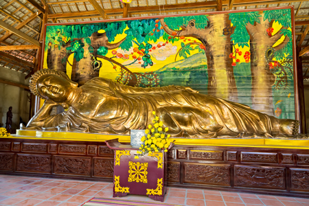 Reclining Sleep Golden Buddha statues supporting his head with his hand . Buddhist holiday - Happy Bodhi day achieved enlightenment.
