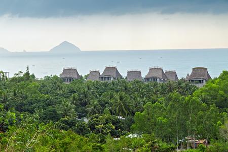 Tropical beach Bungalow house Eco hotel resort tourism concept nature background wooden hut coast village.
