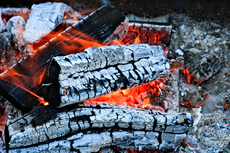 Burning firewood, charcoal burning ready to grill closeup fireplace. Heat from the fire Campfire. Reklamní fotografie