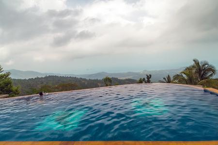 Hotel swimming pool blue water. surface of blue swimming pool 版權商用圖片