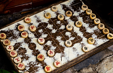 Traditional Xiang Qi Wooden Chinese Chess Checker Game. Old wooden chess lines board chinese chess strategy game played.