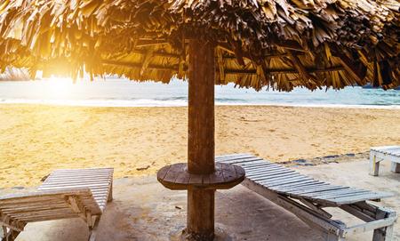 Sunbathing on the beach chairs and sun umbrella on the Sandy island sea beach. sunbed deckchair at the beach Cat co, Cat ba island, VIETNAM