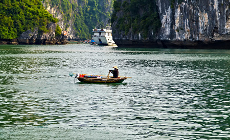 Tourist boat high cliff most popular landscape for travel Vietnam. Halong Bay Tour Cruise Discover Rock islands spectacular limestone.