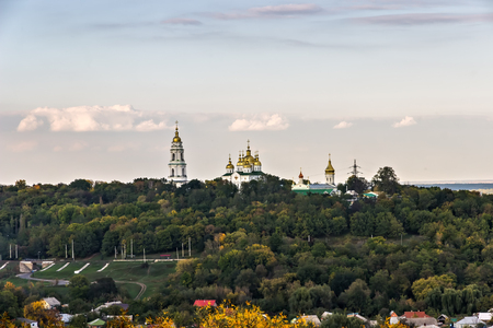 Landscape Poltava Cross Exaltation Women's Monastery cupolas. Orthodox monastery in the Poltava Diocese. Bell tower in the late Baroque style. Travel in Poltava land Ukraine.