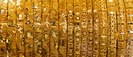 """Gold jewelry. display in gold market famous """"Golden souk"""" in Dubai UAE."""