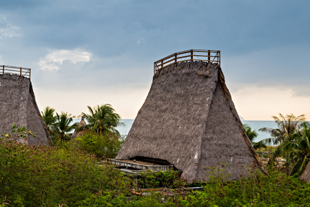 Bungalow Straw Roof. Eco hotel resort tourism concept nature background. Stockfoto