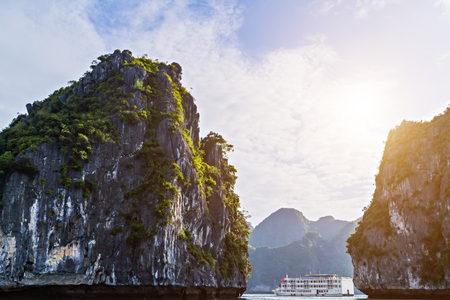 Halong bay islands sea landscape. Panoramic view Rock islands in South China Sea, Vietnam. Tourist attraction grottos natural cave formations.
