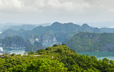 Aerial view Halong bay islands mountains in South China Sea, Vietnam. Tourist attraction of Halong bay islands, spectacular limestone karsts, grottos natural cave formations.