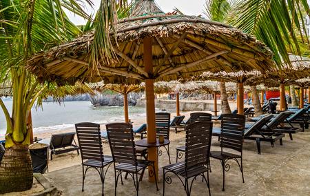 Beach chairs on the tropical sand beach sun umbrella. sunbed deckchair at the beach. Cat ba island, VIETNAM Stok Fotoğraf