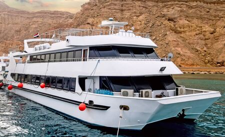Motor yacht seascape Egypt coastline Sinai mountains Africa. Landscape of the Red Sea. Vacation destination concept. Stock Photo